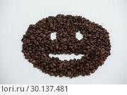 Купить «Coffee beans forming smiley face», фото № 30137481, снято 6 октября 2016 г. (c) Wavebreak Media / Фотобанк Лори