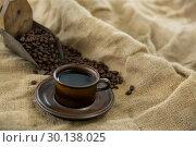 Купить «Black coffee, roasted beans and scoop on sack», фото № 30138025, снято 6 октября 2016 г. (c) Wavebreak Media / Фотобанк Лори