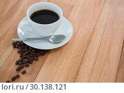 Купить «Black coffee with roasted coffee beans», фото № 30138121, снято 6 октября 2016 г. (c) Wavebreak Media / Фотобанк Лори