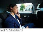 Купить «Business executive talking on mobile phone in car», фото № 30139017, снято 5 октября 2016 г. (c) Wavebreak Media / Фотобанк Лори