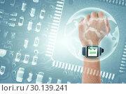 Composite image of cropped hand wearing watch. Стоковое фото, агентство Wavebreak Media / Фотобанк Лори
