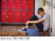 Купить «Sad schoolboy sitting on staircase», фото № 30140149, снято 19 ноября 2016 г. (c) Wavebreak Media / Фотобанк Лори