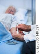 Купить «Doctor testing diabetes of senior patient with insulin pen», фото № 30140797, снято 5 декабря 2016 г. (c) Wavebreak Media / Фотобанк Лори