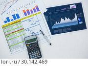 Купить «Close-up of graphs, documents and calculator», фото № 30142469, снято 24 августа 2016 г. (c) Wavebreak Media / Фотобанк Лори