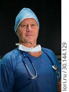 Купить «Portrait of male surgeon in scrubs», фото № 30144129, снято 19 ноября 2016 г. (c) Wavebreak Media / Фотобанк Лори