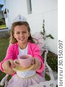 Купить «Girl in fairy costume holding coffee cup», фото № 30150097, снято 23 февраля 2019 г. (c) Wavebreak Media / Фотобанк Лори