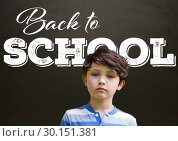 Купить «Back to school text on blackboard with boy», фото № 30151381, снято 24 июля 2017 г. (c) Wavebreak Media / Фотобанк Лори