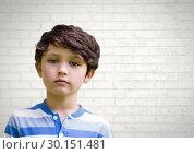 Купить «Boy in front of bright wall», фото № 30151481, снято 24 июля 2017 г. (c) Wavebreak Media / Фотобанк Лори