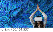 Woman in VR headset raising hands against blue colour lines background. Стоковое фото, агентство Wavebreak Media / Фотобанк Лори