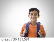 Купить «Schoolboy holding bag with grey background», фото № 30151581, снято 24 июля 2017 г. (c) Wavebreak Media / Фотобанк Лори