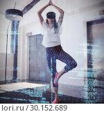 Купить «Woman doing yoga while using virtual reality headset on carpet », фото № 30152689, снято 19 марта 2017 г. (c) Wavebreak Media / Фотобанк Лори