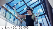Купить «Composite image of businesswoman gesturing while looking through virtual reality simulator over whit», фото № 30153005, снято 15 сентября 2017 г. (c) Wavebreak Media / Фотобанк Лори