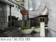 Купить «Male chef reading order in the kitchen», фото № 30153185, снято 22 августа 2017 г. (c) Wavebreak Media / Фотобанк Лори