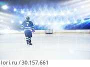 Купить «Composite image of rear view of player holding ice hockey stick», фото № 30157661, снято 15 ноября 2018 г. (c) Wavebreak Media / Фотобанк Лори