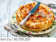 Купить «Puff pastry pie dish with potatoes and rosemary», фото № 30159205, снято 18 февраля 2019 г. (c) Марина Сапрунова / Фотобанк Лори