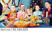 Купить «Family celebrating New Year together», фото № 30160605, снято 28 декабря 2017 г. (c) Яков Филимонов / Фотобанк Лори