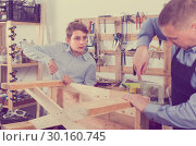 Купить «teacher and boy chiselling a wooden bench in workshop», фото № 30160745, снято 17 мая 2017 г. (c) Яков Филимонов / Фотобанк Лори