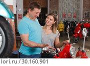 Купить «Male with female are talking about new motobikes», фото № 30160901, снято 8 мая 2018 г. (c) Яков Филимонов / Фотобанк Лори