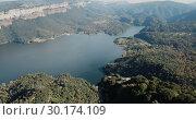 Купить «Scenic panoramic view from high point of Sau reservoir, Catalonia, at autumn day», видеоролик № 30174109, снято 16 ноября 2018 г. (c) Яков Филимонов / Фотобанк Лори