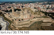 Купить «Panoramic view from drone of Catalan city of Lleida with medieval Cathedral of St. Mary of La Seu Vella», видеоролик № 30174165, снято 25 июля 2018 г. (c) Яков Филимонов / Фотобанк Лори