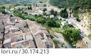 Купить «Aerial view of Romanesque Benedictine Abbey Sainte-Marie d'Orbieu in commune of Lagrasse in southern France», видеоролик № 30174213, снято 26 октября 2018 г. (c) Яков Филимонов / Фотобанк Лори