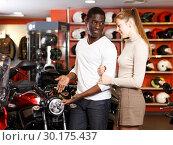 Купить «couple in motorcycle shop choosing new vehicle», фото № 30175437, снято 16 января 2019 г. (c) Яков Филимонов / Фотобанк Лори