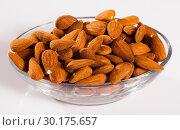 Купить «Image of roasted salt almonds on glass bowl, nobody», фото № 30175657, снято 16 июля 2019 г. (c) Яков Филимонов / Фотобанк Лори