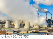 Купить «Power plant pipes and cooling towers on the background of the panorama of the winter city against blue sky», фото № 30175757, снято 17 июня 2019 г. (c) Mikhail Starodubov / Фотобанк Лори