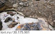 Купить «River near Chalaadi glacier in Caucasus mountains», видеоролик № 30175901, снято 30 января 2019 г. (c) Mikhail Starodubov / Фотобанк Лори