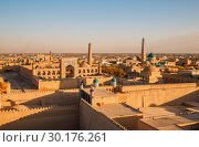 Купить «Top view of the old city of Khiva, Ichan-Kala fortress at sunset», фото № 30176261, снято 21 октября 2016 г. (c) Юлия Бабкина / Фотобанк Лори
