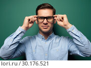 Купить «Young handsome businessman in formal wear and glasses», фото № 30176521, снято 13 декабря 2018 г. (c) Pavel Biryukov / Фотобанк Лори