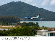 Купить «Boeing 737 Nokair arrives at the airport», фото № 30178113, снято 30 ноября 2016 г. (c) Игорь Жоров / Фотобанк Лори