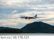 Купить «Malaysian Airlines flying to land from the sea», фото № 30178121, снято 29 ноября 2016 г. (c) Игорь Жоров / Фотобанк Лори