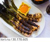 Купить «Grilled calcots with romesco sauce», фото № 30178605, снято 25 марта 2019 г. (c) Яков Филимонов / Фотобанк Лори