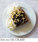 Купить «Chocolate cake with whipped cream», фото № 30178609, снято 23 марта 2019 г. (c) Яков Филимонов / Фотобанк Лори