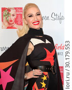 Купить «Gwen Stefani at a backstage photocall prior to officially turning on the 2017 Westfield Shopping Centre Christmas Lights, White City, London Featuring...», фото № 30179553, снято 30 ноября 2017 г. (c) age Fotostock / Фотобанк Лори
