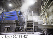 Купить «Industrial machinery for converting cellulose into a sheet of paper.», фото № 30189421, снято 12 февраля 2018 г. (c) age Fotostock / Фотобанк Лори