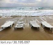 Abandoned sunbeds on Golden Beach. North Cyprus, Karpass Peninsula. Стоковое фото, фотограф Andre Maslennikov / age Fotostock / Фотобанк Лори