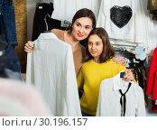 Mother and daughter choosing pretty blouse. Стоковое фото, фотограф Яков Филимонов / Фотобанк Лори