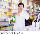 Купить «Pharmacist ready to assist in choosing at counter», фото № 30196253, снято 31 января 2017 г. (c) Яков Филимонов / Фотобанк Лори