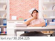 Купить «Young student preparing for college exams», фото № 30204225, снято 14 сентября 2018 г. (c) Elnur / Фотобанк Лори