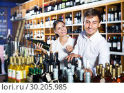 Купить «Couple buying bottle of wine», фото № 30205985, снято 1 июня 2020 г. (c) Яков Филимонов / Фотобанк Лори