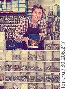 Купить «Man showing counter with details for plumbing», фото № 30206217, снято 4 мая 2017 г. (c) Яков Филимонов / Фотобанк Лори