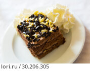 Купить «Chocolate cake with whipped cream», фото № 30206305, снято 12 июля 2020 г. (c) Яков Филимонов / Фотобанк Лори