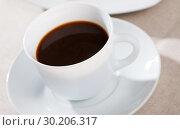 Купить «Picture of cup of fresh black coffee americano on table», фото № 30206317, снято 21 марта 2019 г. (c) Яков Филимонов / Фотобанк Лори