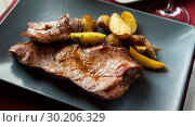Купить «Picture of delicious fried iberian pork with fried potatoes at plate», фото № 30206329, снято 17 ноября 2019 г. (c) Яков Филимонов / Фотобанк Лори