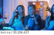 Купить «friends eating pizza and drinking wine at home», видеоролик № 30206621, снято 12 января 2019 г. (c) Syda Productions / Фотобанк Лори