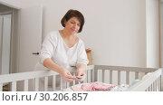 Купить «happy pregnant woman setting baby clothes at home», видеоролик № 30206857, снято 18 февраля 2019 г. (c) Syda Productions / Фотобанк Лори