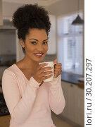 Купить «Beautiful woman having coffee in kitchen at home», фото № 30207297, снято 7 ноября 2018 г. (c) Wavebreak Media / Фотобанк Лори
