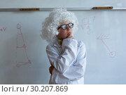 Купить «Schoolboy in white wig standing in laboratory at school», фото № 30207869, снято 10 ноября 2018 г. (c) Wavebreak Media / Фотобанк Лори